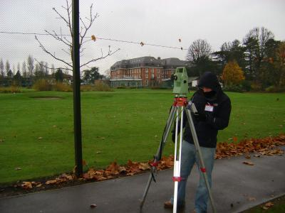 land surveyor at a sports complex